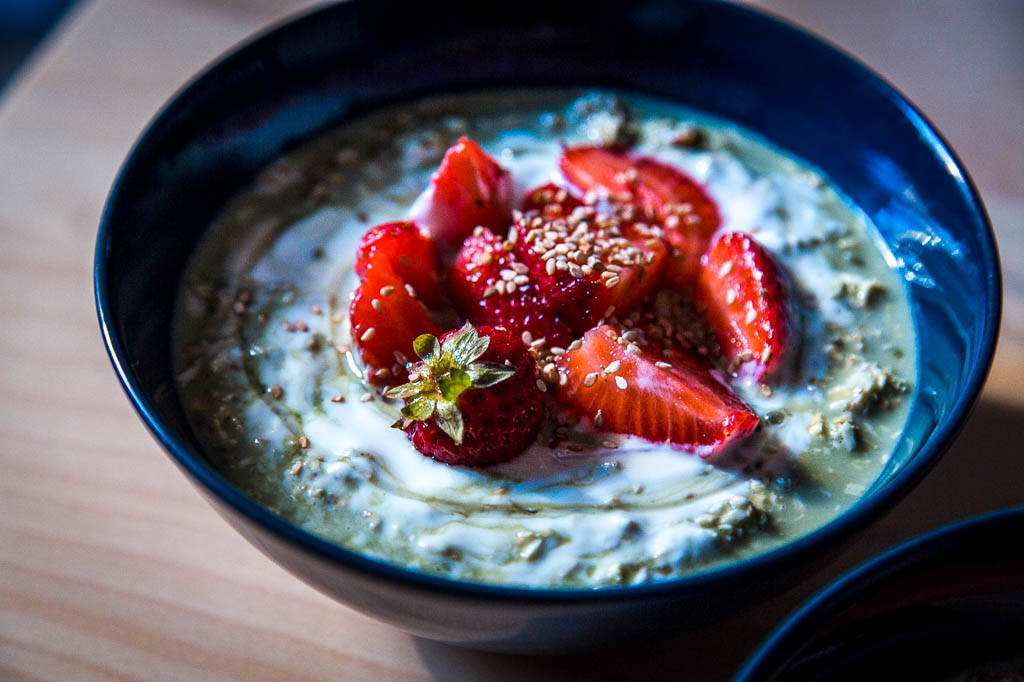 Matcha overnight oats with strawberry topping